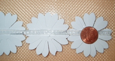 Hot Glue a Penny or weight on the bottom flower