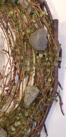 nest clock moss rocks before