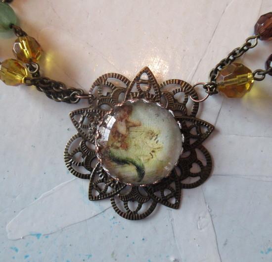 bracelet to mermaid necklace closeup