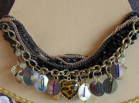 cat lady necklace closeup